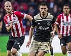 """Foto: PSV-fans hekelen 'Ajax-krantje': """"Wegwezen!"""""""