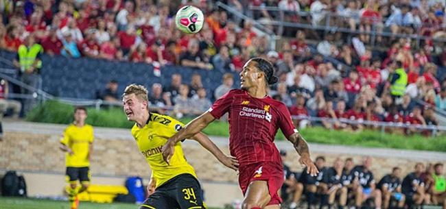 Foto: Van Dijk en Wijnaldum onderuit tegen Borussia Dortmund